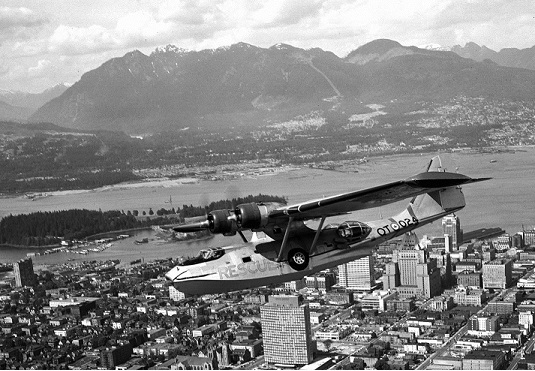 121 Search and Rescue Squadron Canso aircraft over the city of Vancouver.